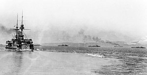 HMS Majestic (1895) - Majestic steaming out of Mudros harbour with several destroyers