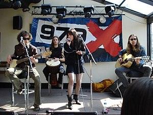 Halestorm - Halestorm performing an acoustic set in 2009. Left to right: Josh Smith, Arejay Hale (back), Lzzy Hale, Joe Hottinger