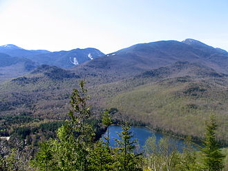 Adirondack Mountain Club - Heart Lake from Mount Jo, Algonquin Peak at right.  The Loj clearing is at lower left.