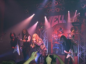 Helloween - Helloween performing in 2006 in Nuremberg. From left to right: Sascha Gerstner, Markus Grosskopf, Andi Deris, and Michael Weikath, with Daniel Löble in the back.