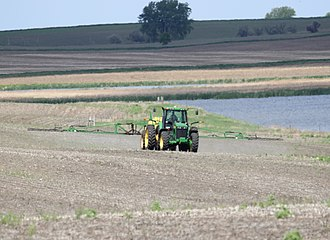 Herbicide - Herbicides being sprayed from the spray arms of a tractor in North Dakota.