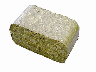 Biomass briquettes - Briquette made by a Ruf briquetter out of hay