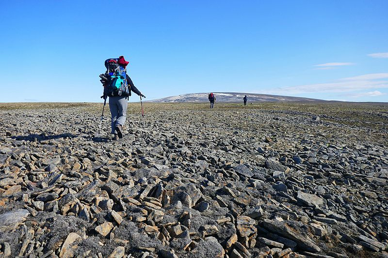 Hiking the rocks below the Stoke's Range in Qausuittuq National Park, place in Nunavut