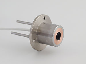 Heat flux sensor - Gardon or Schmidt Boelter gauge showing the instrument main components: metal body, black sensor, water cooling pipe in and out, mounting flange, and cable. Dimensions: diameter housing is 25mm. Photo shows model SBG01.