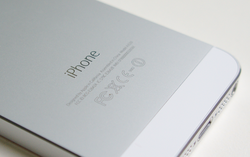 "The ""iPhone"" wordmark on the back of an iPhone 5S."