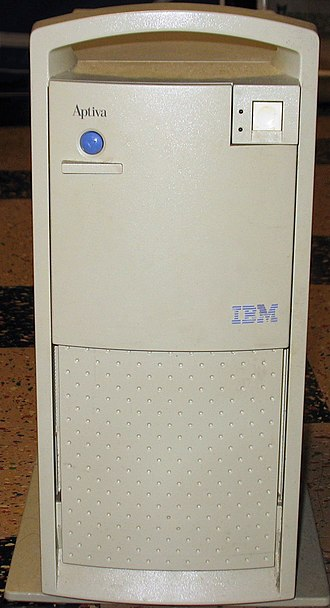 IBM Aptiva - An IBM Aptiva tower unit from 1996. Pressing the blue button caused the upper panel to slide down and reveal the removable disk drives.