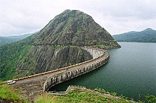 Curved road along the top of the large Idukki Dam