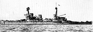 HMS Indomitable (1907) - Indomitable in 1918. Note the aircraft carried on the midships turrets.