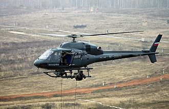 """SOBR - SOBR """"Rus"""" operators demonstrate the arrest of armed suspects in a cargo truck with the help of aviation and explosives. AS355N Ecureuil 2 landed a group of Rus."""