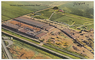 """Simplot - A view of the Simplot plant in Caldwell, Idaho, circa 1930-1945. The caption in the image states """"World's Largest Dehydrating Plant."""""""