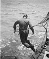 J M Dickison entering into the water with diving equipment on, Bikini Atoll, 1947 (DONALDSON 246).jpeg