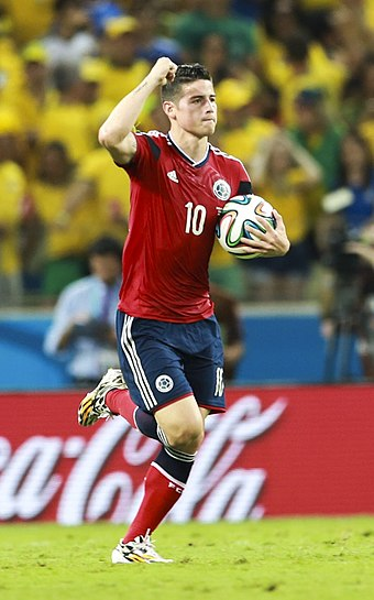 James celebrates after scoring a penalty against Brazil at the 2014 World Cup. He became the first player to score in every single game he played since Rivaldo at the 2002 edition. James Rodriguez.jpg