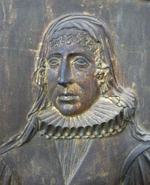 John Wyndham (1558–1645) - Joanna Portman (d. 13 September 1633), wife of Sir John Wyndham. Gilt-bronze cast relief plaque, on purbeck marble slab, Watchet Church