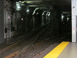 Kenmore (MBTA station) - View looking inbound from the outbound C/D platform.  Having crossed above the mainline tracks, the Kenmore loop joins from the left, connecting to the outbound C/D track visible in foreground.