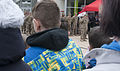 Killer Troop interact with Polish citizens during a static display 150327-A-IK997-032.jpg