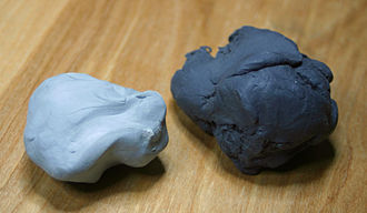 Kneaded eraser - Two kneaded erasers. A newer eraser is on the left, and an older eraser on the right. The older eraser is darker due to the graphite and charcoal dust that has become incorporated into the eraser.