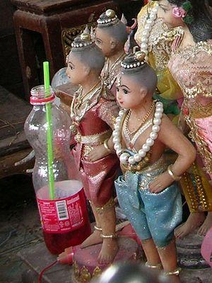 Kuman Thong - Kuman Thong figures at a shrine in Ratchaburi Province