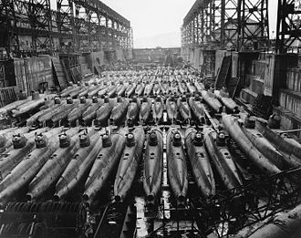 "Midget submarine - Some 80 Japanese Type C (""Koryu"") Midget Submarines in a dry dock at Kure, October 19, 1945"