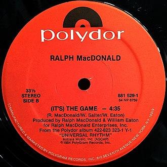 "Ralph MacDonald - MacDonald's 1984 single ""(It's) the Game"" appeared on his album Universal Rhythm."
