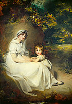 Woman in a white bonnet and a small child
