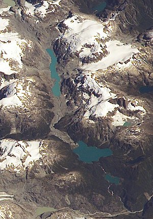 Hornopirén National Park - Unexplored Lake is the largest lake visible in lower half of the image.