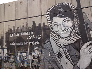 Leila Khaled - Leila Khaled graffiti on the Israeli West Bank barrier near Bethlehem.