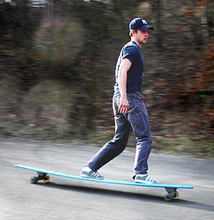 Riding a longboard downhill