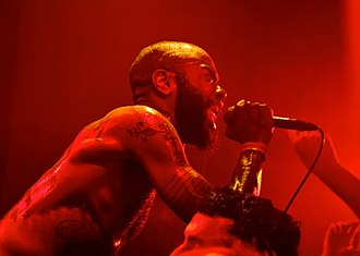 MC Ride - MC Ride performing with Death Grips at Festsaal Kreuzberg in 2012.