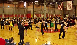 Latin American culture - Intermediate level international-style Latin dancing at the 2006 MIT ballroom dance competition. A judge stands in the foreground.