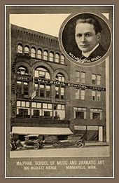 Old five story building with two old cars parked in front, sign says MUSIC - MAC PHAIL SCHOOL - DRAMA. Circular inset at upper right of head of male in late twenties, wearing white shirt, black suit and tie, labeled WILLIAM MacPHAIL. Under photo says MacPHAIL SCHOOL OF MUSIC AND DRAMATIC ART/816 NICOLLET AVENUE MINNEAPOLIS, MINNESOTA.