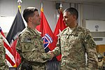 Maj. Robert Whisenant coined by Maj. Gen. Stephan Townsend on Bargram Air Field 141003-A-XR785-001.jpg