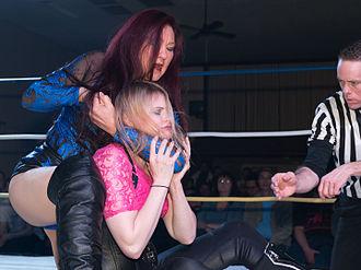 Malia Hosaka - Hosaka putting Ingrid Isley in a headlock while the referee checks