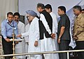 Manmohan Singh lighting the lamp at the foundation stone laying ceremony of the Kishangarh Airport near Ajmer, in Rajasthan. The Union Minister for Civil Aviation, Shri Ajit Singh, the Chief Minister of Rajasthan.jpg