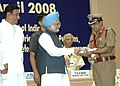 Manmohan Singh presenting the Prime Minister's Award for Excellence in Public Administration for the year 2006-07 to Shri J.K. Tripathy (IPS), Inspector General of Police, Economic Offences Wing Government of Tamil Nadu.jpg