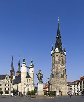 Marktkirche Unser Lieben Frauen - Market Place with the Red Tower, the Marktkirche Unser Lieben Frauen and a statue of Handel