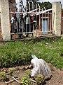 Mass Grave at Genocide Site with Schoolchildren Looking On - Kibuye (Karongi) - Rwanda (8971681796).jpg