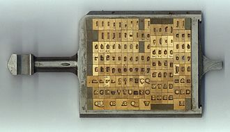 Hot metal typesetting - A Monotype composition case showing engraved matrices.