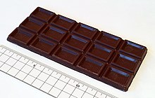 Открытая плитка молочного шоколада Meiji