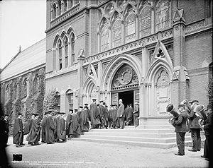 History and traditions of Harvard commencements - Seniors entering Sanders Theatre for Class Day exercises (late 19th or early 20th century)