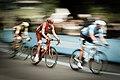 Men cycling in Turin city (Unsplash).jpg