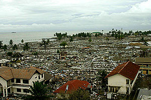 Library damage resulting from the 2004 Indian Ocean earthquake - An aerial view of the coastal city of Meulaboh, Indonesia, after the tsunami. The public library in Meulaboh was completely destroyed.