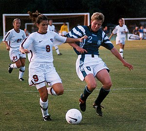 Women's association football - Mia Hamm (left) battles with German defender Kerstin Stegemann.