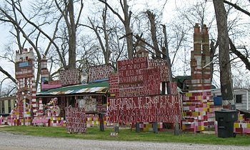 Church with multiple hand made signs, Mississi...