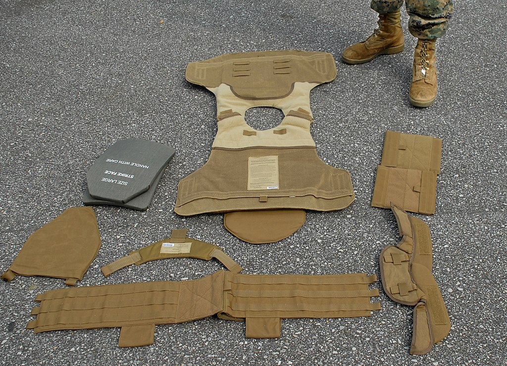 Individual pieces composing the Modular Tactical Vest worn by U.S. Marines, including SAPI plates (gray, at top left)