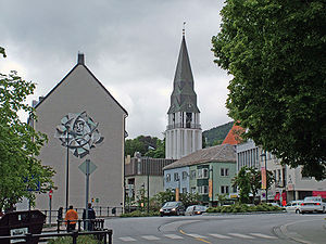 Molde - Molde's main street and commercial center. Molde Cathedral (orange roof on far right) with its freestanding bell tower replaces the church that was destroyed during World War II