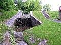 Motolský potok, pod hrází Mlýnského rybníka.jpg