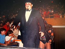 Mr Fuji as the manager of Demolition, wearing their face paint