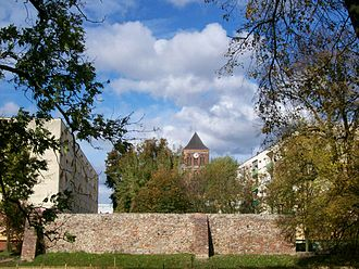 Choszczno - Mediaeval town wall with St. Mary's church in the background