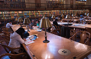 Public library - Patrons studying and reading at the New York Public Library Main Branch.