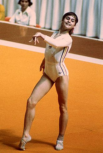 Nadia Comăneci - Comăneci doing the floor exercise at the 1976 Olympics